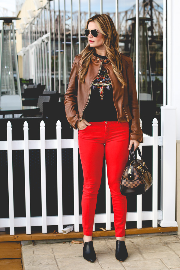 Red pants and leather jacket style