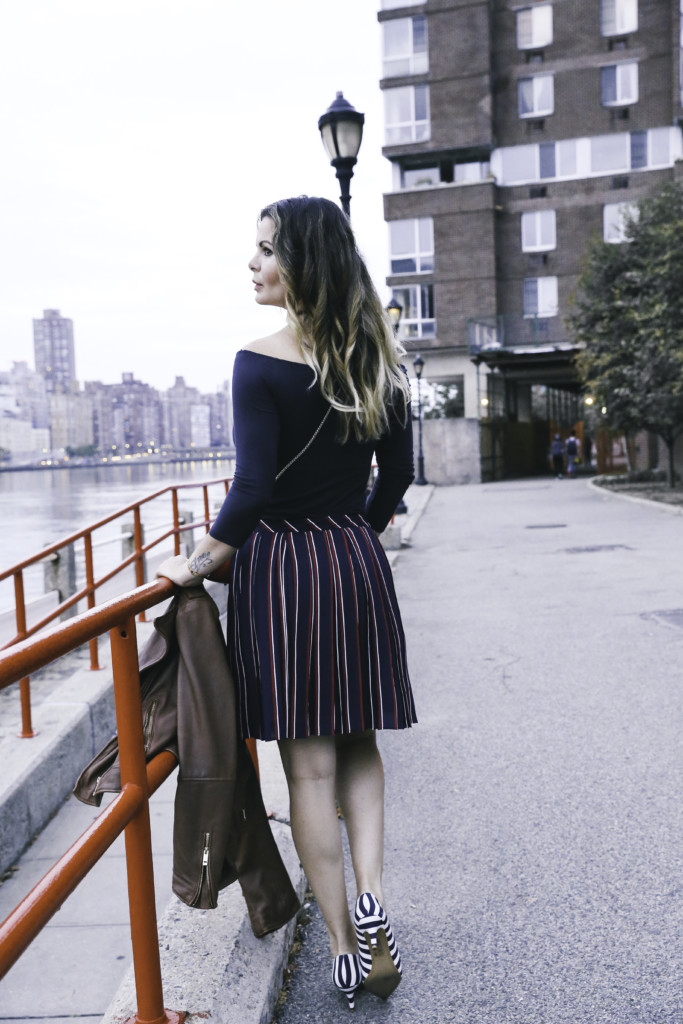 Striped pleated skirt and leather jacket