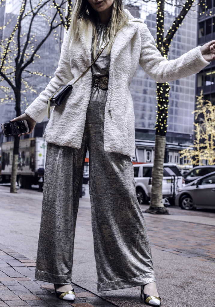 Glamourim lifestyle blogger wearing NY&CO Metallic jumpsuit and white furry coat by coalition LA