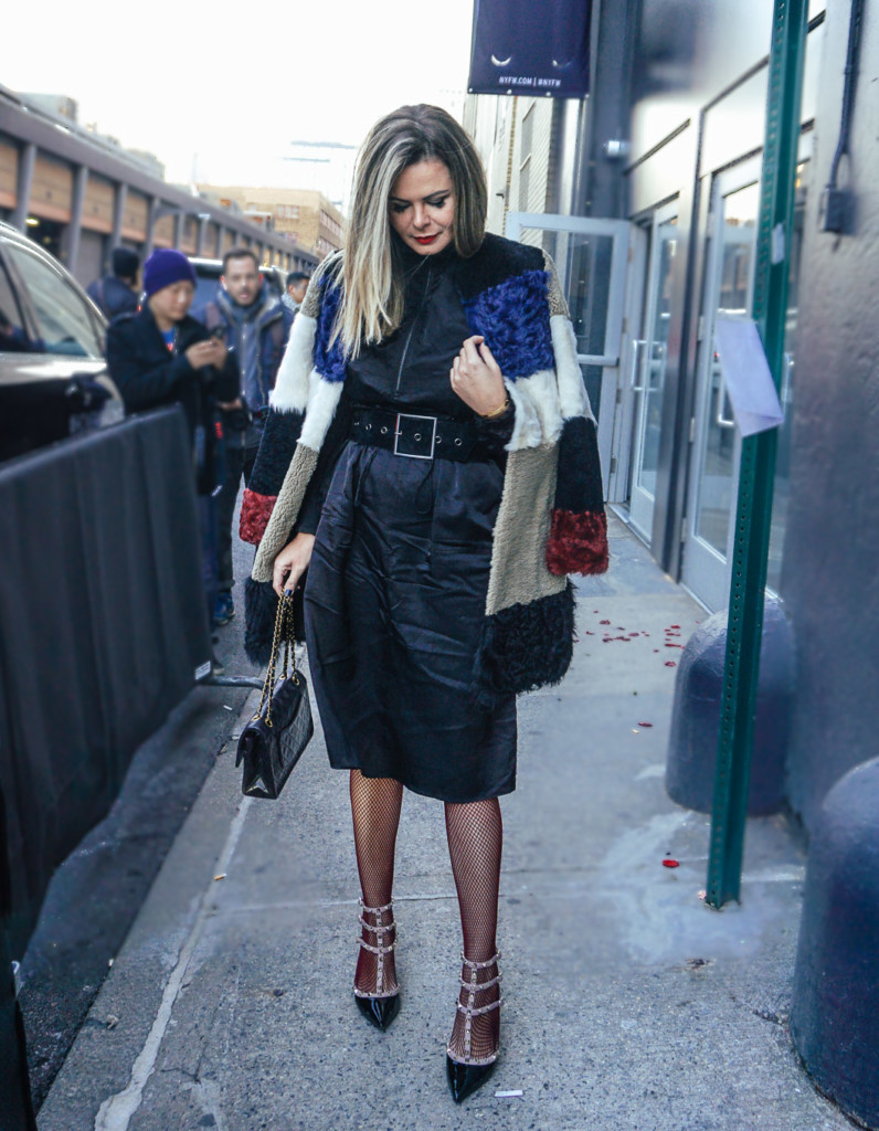 NYFW glamourim lifestyle blogger wearing silk ruffle dress and fishnet tights