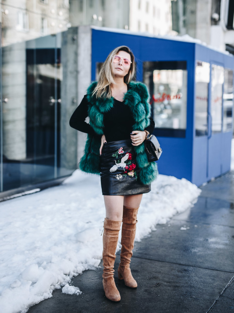 Hilma lifestyle blogger styling a Faux fur vest with embroidered skirt