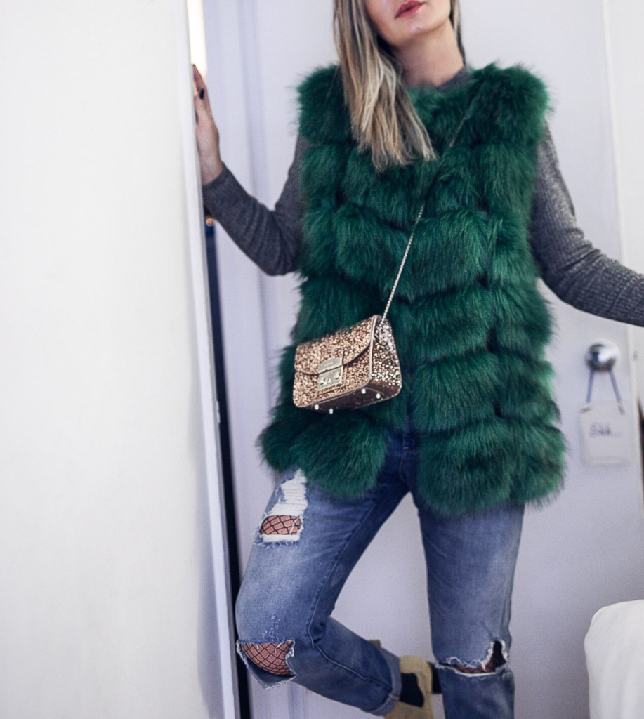 Early Spring outfit dress up your jeans with a faux fur vest by glamourim.com